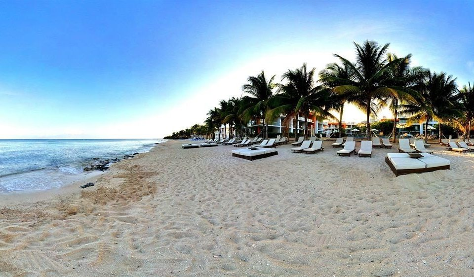 All-inclusive Beachfront Lounge Modern Waterfront sky Beach water ground Nature Ocean shore sandy sand Sea Coast Resort palm arecales lined shade day