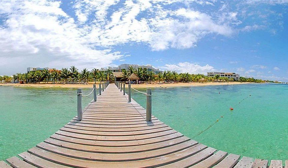 All-inclusive Beachfront Modern Waterfront water sky Beach shore Sea caribbean Ocean Coast walkway Resort Lagoon Pool sand Island Lake tropics overlooking swimming lined