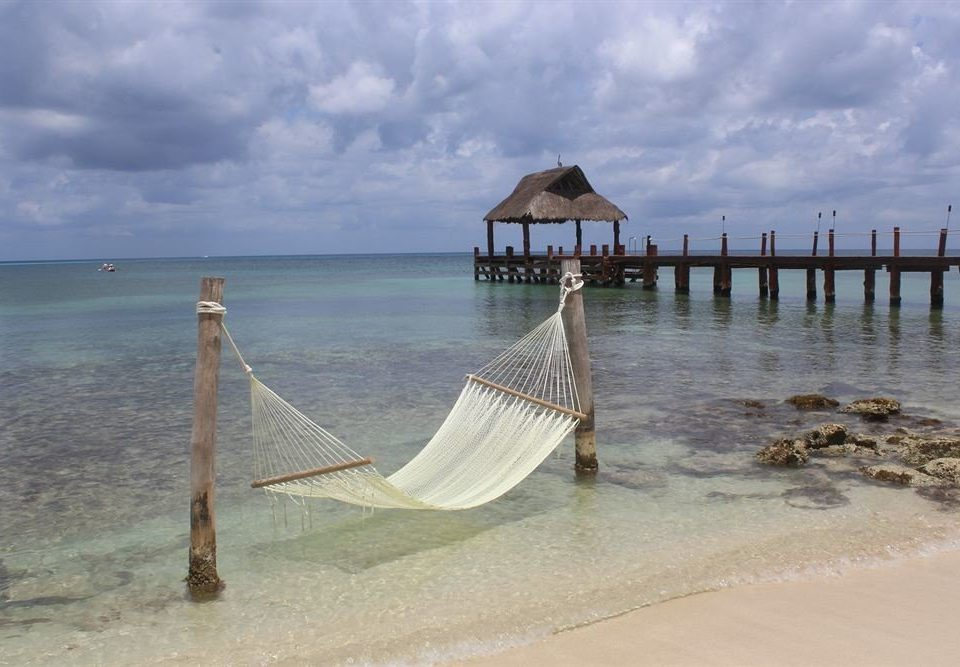 All-inclusive Beachfront Lounge Modern Waterfront sky water Beach shore Sea Nature Ocean Coast sand pier wave material sandy day