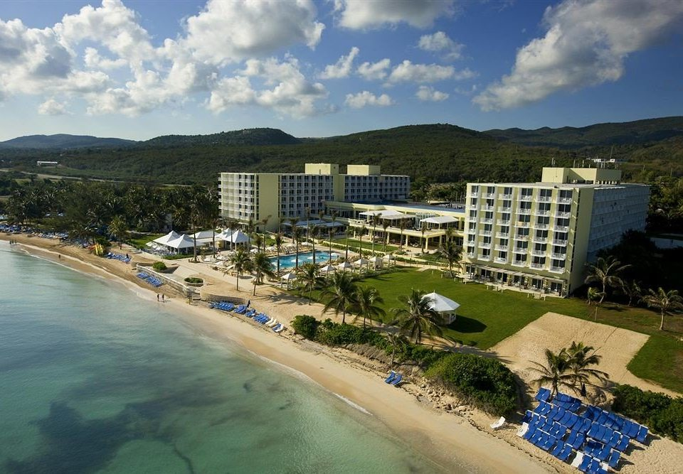 All-inclusive Beachfront Tropical sky water mountain Nature Sea Beach Coast aerial photography Resort shore day