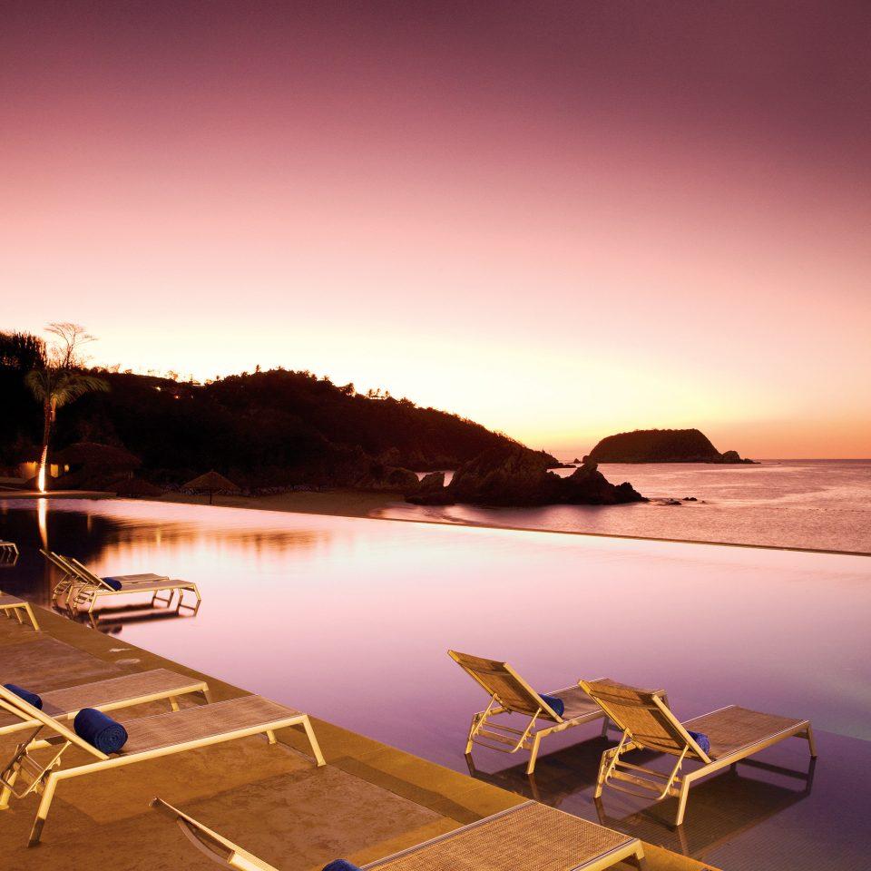 All-inclusive Beachfront Lounge Modern Ocean Sunset Waterfront sky water Sea evening morning dusk Coast Beach sunrise dawn shore