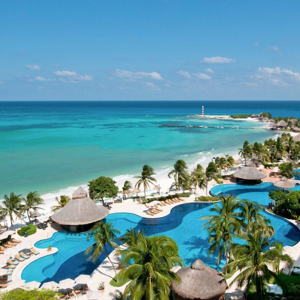 All-inclusive Beach Beachfront Luxury Pool Resort sky water Nature Sea caribbean Ocean shore Coast Lagoon cape islet tropics cove Island reef day