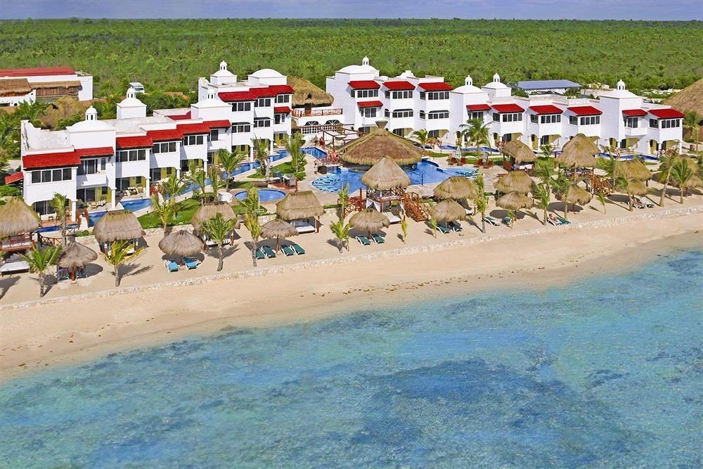 All-inclusive Beach Beachfront Exterior Modern Pool Resort Waterfront Nature shore Coast Sea caribbean sandy