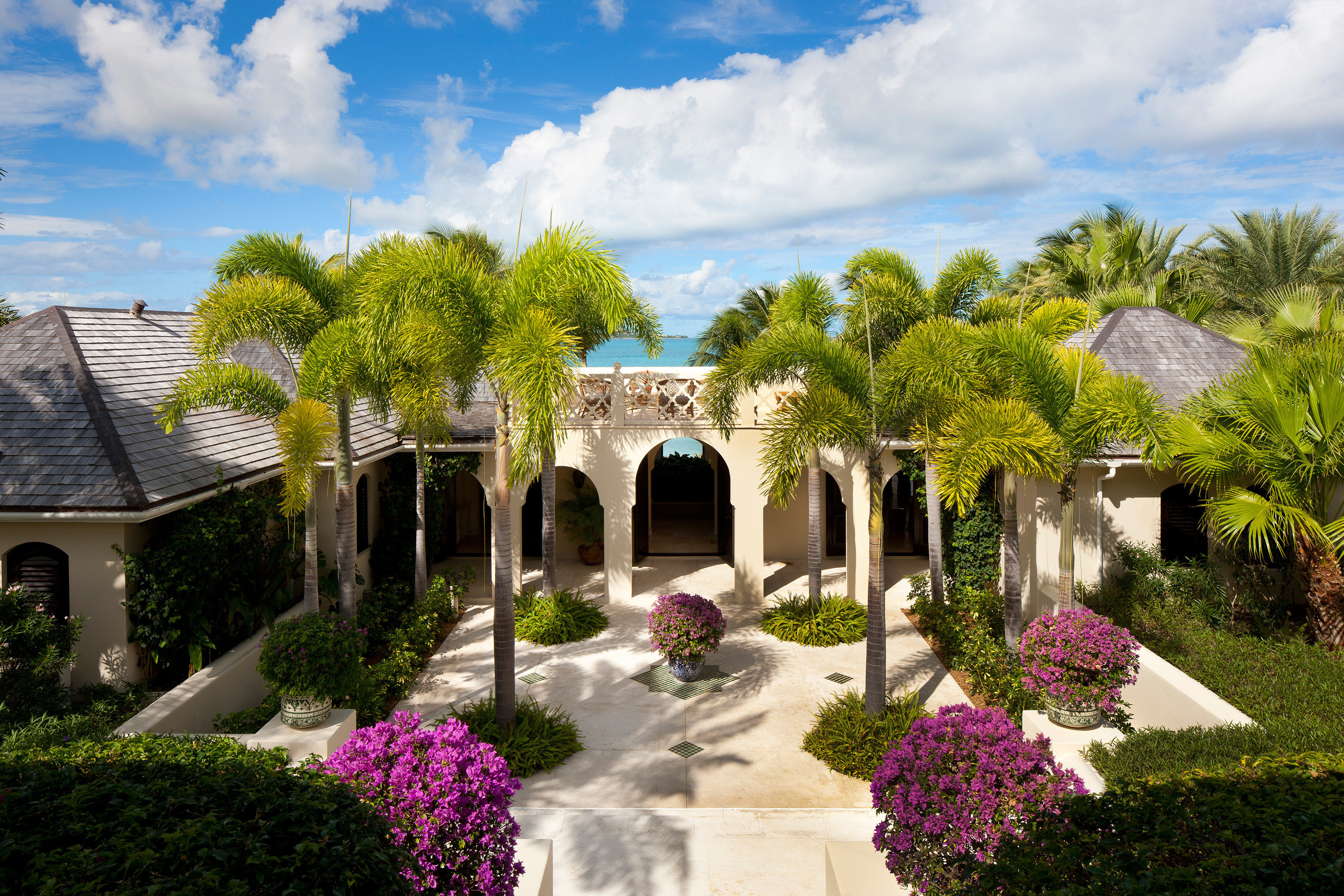 All-inclusive Beach Beachfront Courtyard Exterior Garden Grounds Hotels Island Luxury Resort Trip Ideas Waterfront tree sky flower property flora house home mansion Villa hacienda backyard plant yard lawn Village surrounded stone