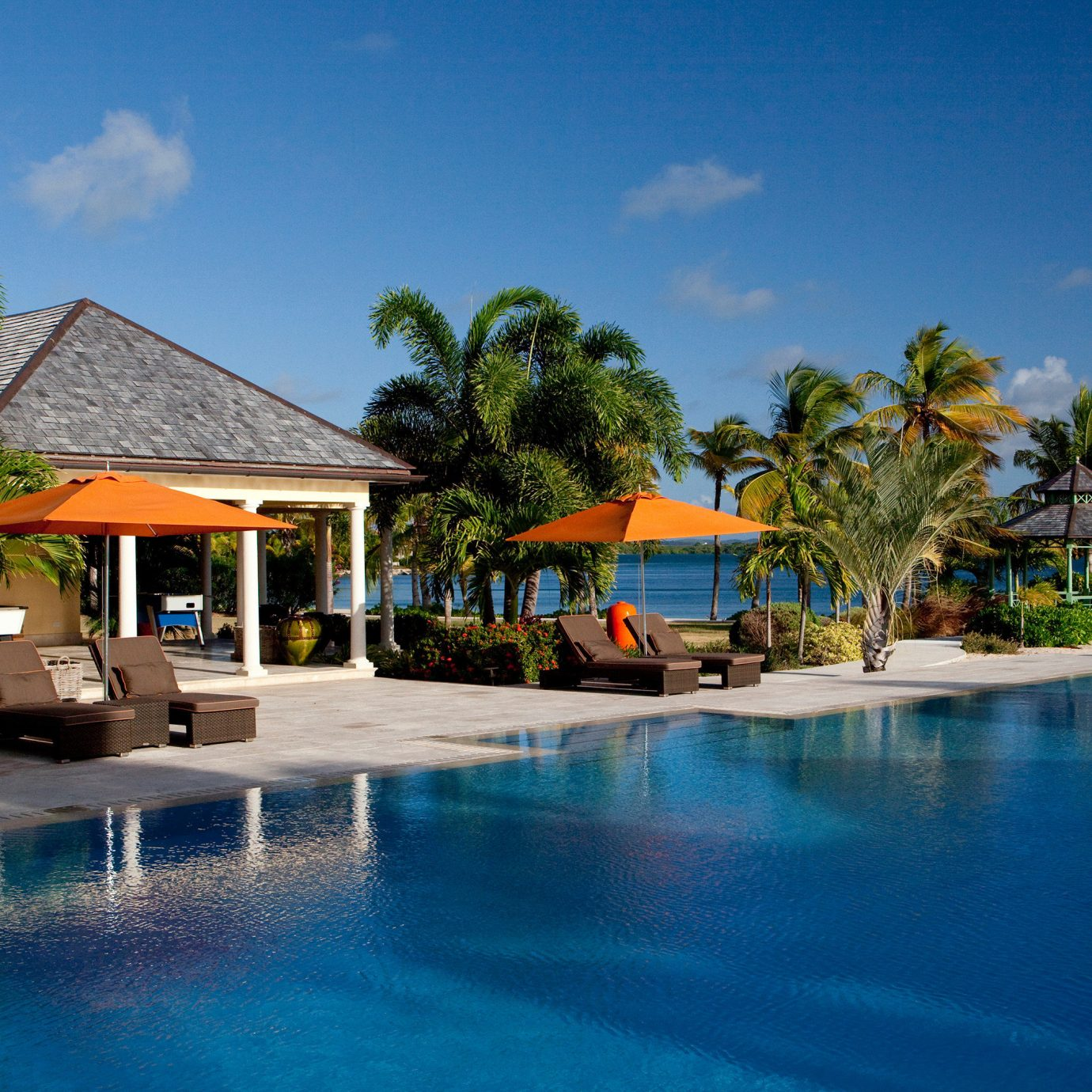 All-inclusive Beach Beachfront Deck Dining Drink Eat Island Luxury Patio Pool Scenic views Waterfront tree sky water Resort swimming pool leisure house caribbean resort town Lagoon Sea tropics Water park swimming lined