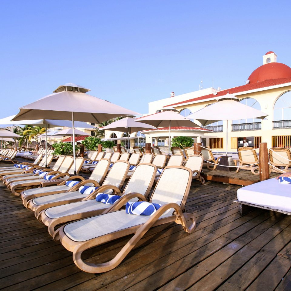All-inclusive Beachfront Deck Lounge sky ground chair wooden leisure Resort Beach walkway dock restaurant marina boardwalk