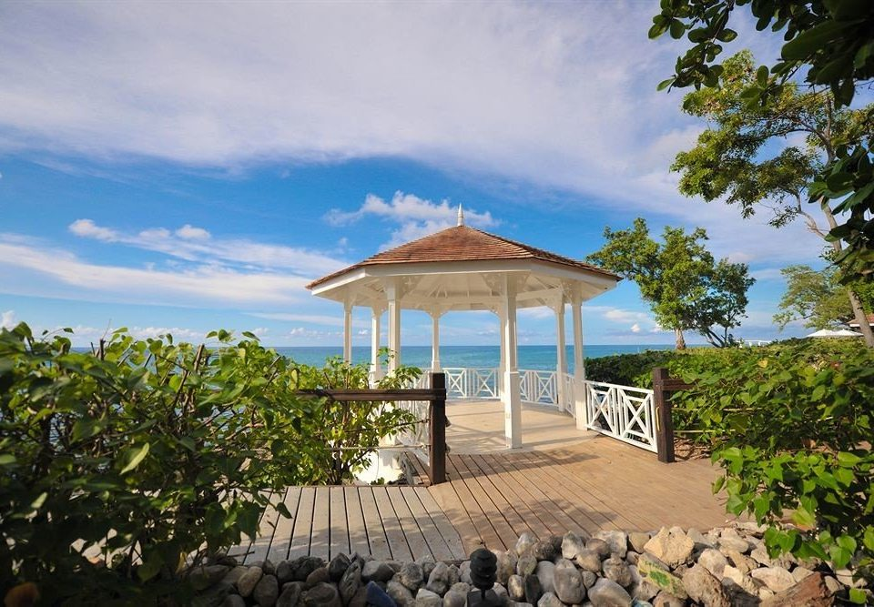 All-inclusive Beachfront Deck Resort Scenic views Tropical tree property building walkway Beach Sea Villa surrounded