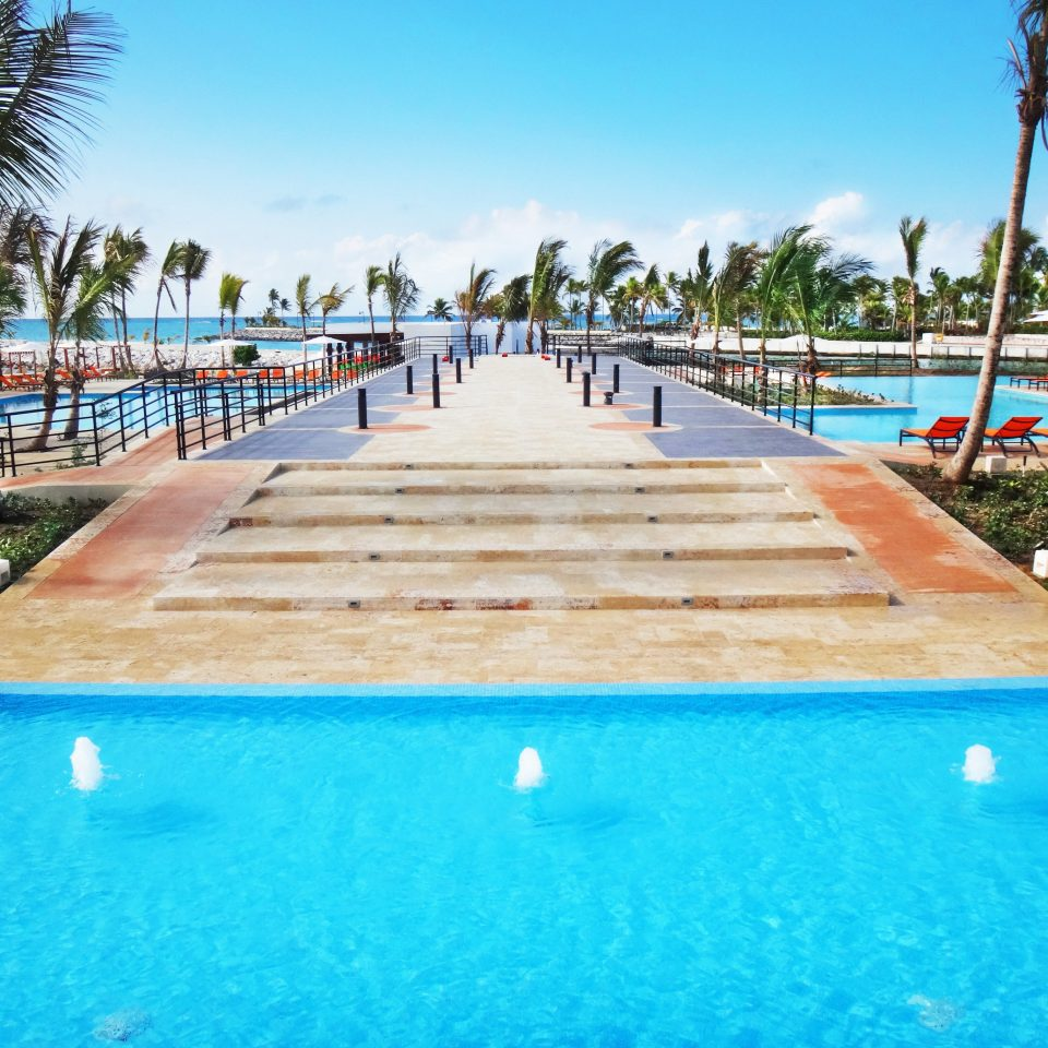 All-inclusive Beachfront Family Pool Resort Romantic sky water swimming pool leisure property Beach board palm resort town marina walkway dock swimming lined Deck
