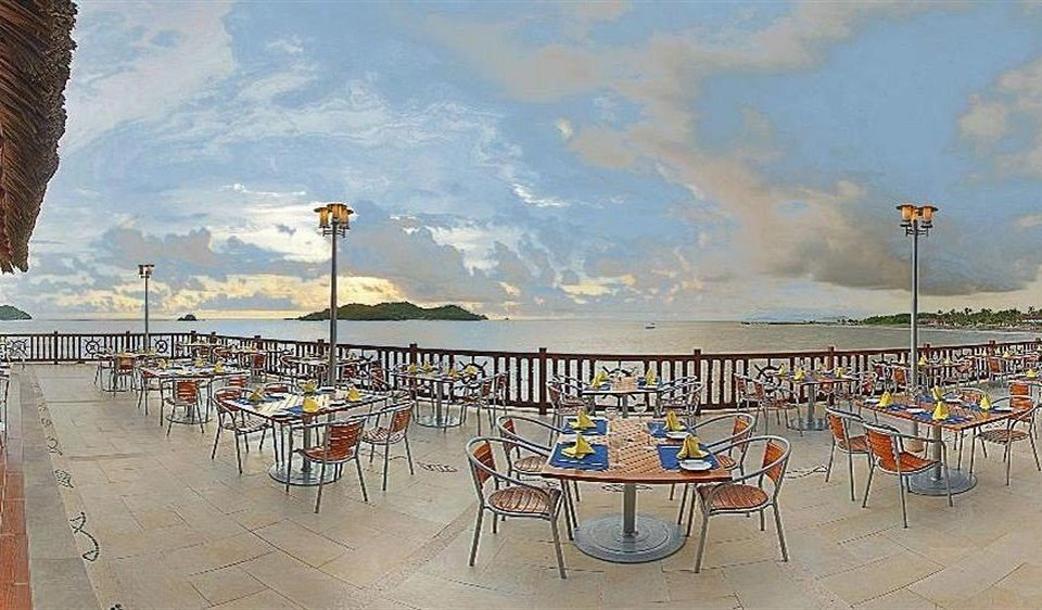 All-inclusive Beachfront Dining Drink Eat Modern Ocean Resort Scenic views Waterfront ground chair Beach walkway boardwalk pier Sea marina plaza dock set