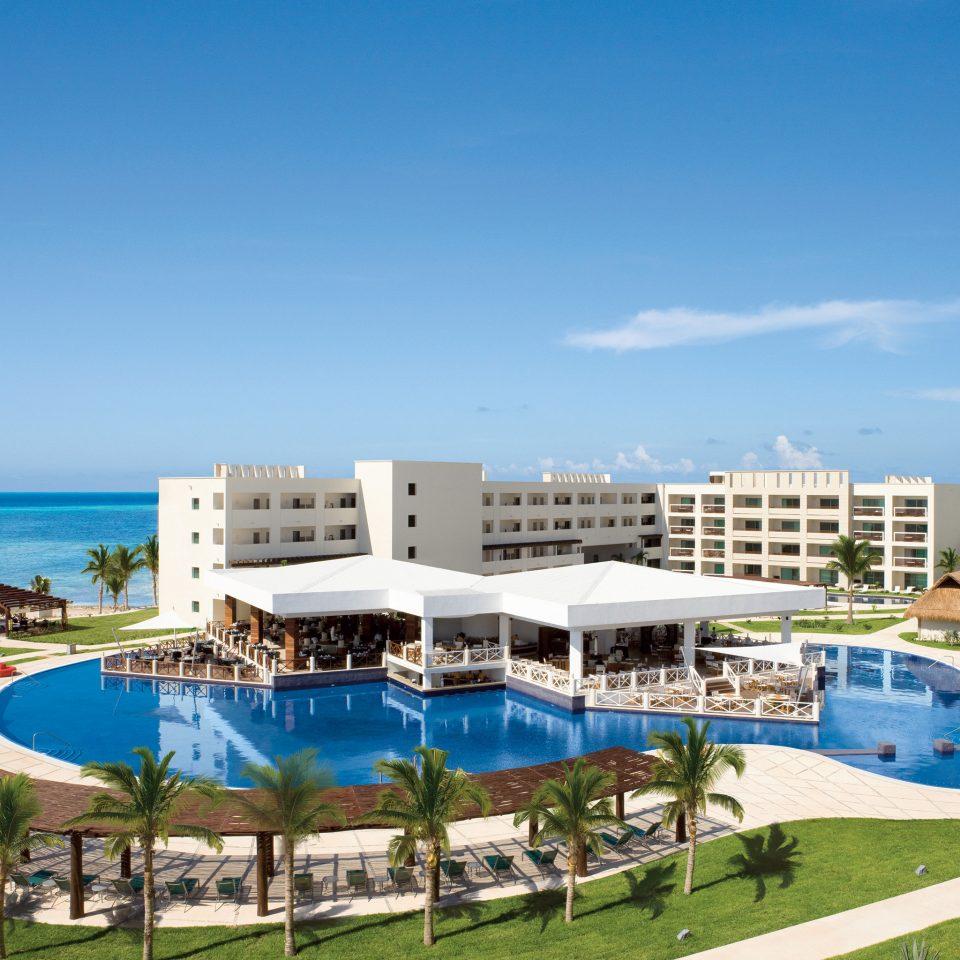 All-inclusive Beachfront Exterior Lounge Luxury Modern Pool sky grass leisure property swimming pool Resort blue lawn marina condominium Ocean Beach shore