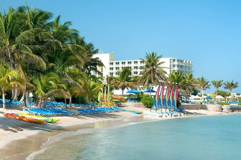 All-inclusive Beachfront Grounds Tropical sky tree Beach leisure Water park Resort caribbean amusement park Sea Nature resort town Lagoon park blue reef tropics palm colorful shore day sandy colored