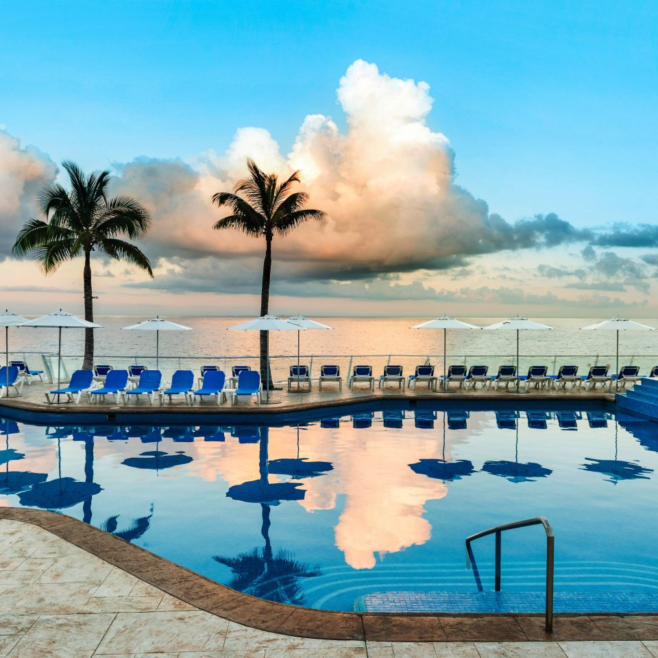 All-inclusive Beachfront Hotels Lounge Luxury Romance sky water swimming pool Sea Resort Ocean Beach arecales caribbean Lagoon shore day