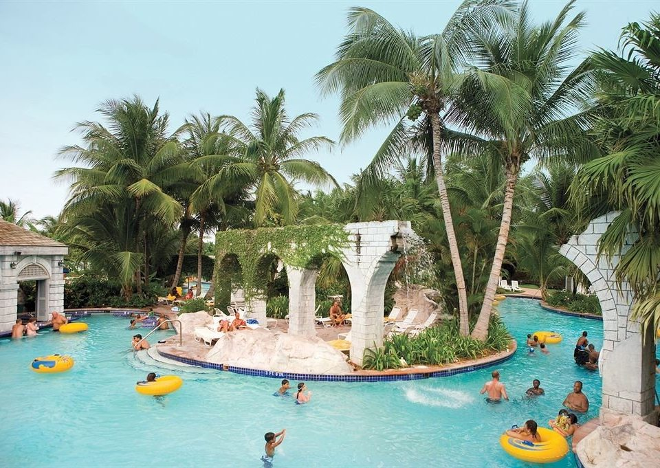 All-inclusive Beachfront Tropical tree leisure Resort plant Water park swimming pool amusement park caribbean palm arecales resort town tropics Lagoon Beach Sea