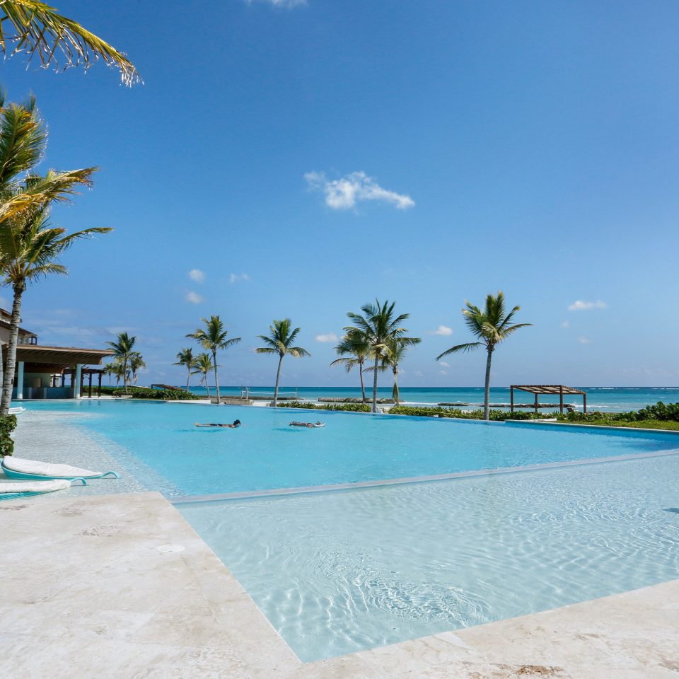 All-inclusive Beach Beachfront Play Pool Resort sky tree water swimming pool property leisure caribbean Sea shore Nature Ocean arecales Lagoon Villa condominium tropics plant palm
