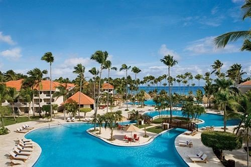 All-inclusive Beach Beachfront Lounge Ocean Pool Tropical Resort sky tree property caribbean swimming pool palm leisure Water park resort town Lagoon amusement park lawn lined reef swimming shore