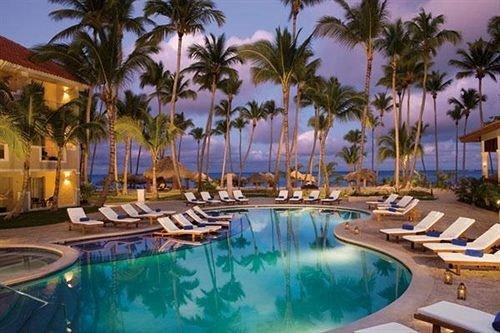All-inclusive Beach Beachfront Lounge Ocean Pool Tropical sky palm tree Resort swimming pool property leisure caribbean Villa condominium resort town mansion eco hotel lined