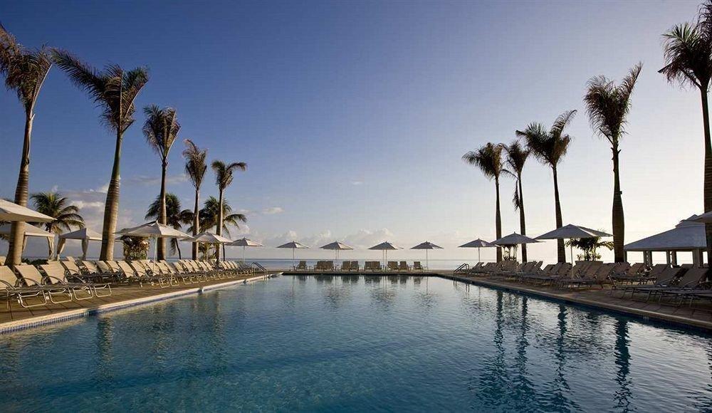 All-inclusive Beachfront Pool Tropical sky water marina landmark Sea Resort palm dock arecales tree palace walkway Beach shore lined plant line