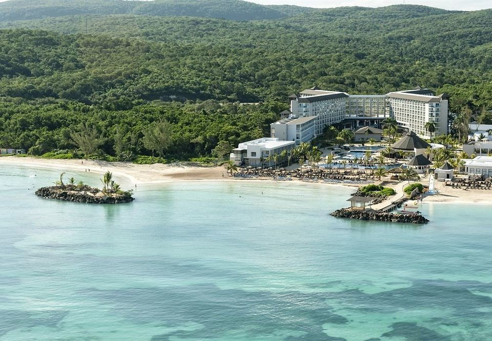All-inclusive Beach Grounds Resort Sea water mountain Boat Coast vehicle islet Ocean cove archipelago Harbor Island Nature cape Lake surrounded traveling