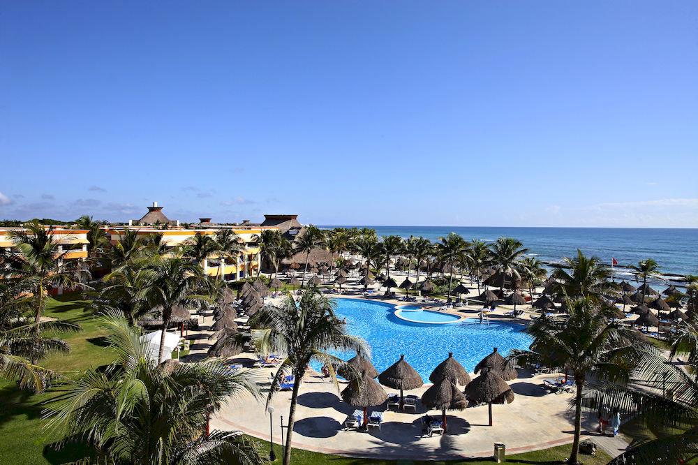 All-inclusive Beach Budget Family Resort Tropical Waterfront sky leisure Sea Ocean Coast caribbean marina cape Lagoon plant shore