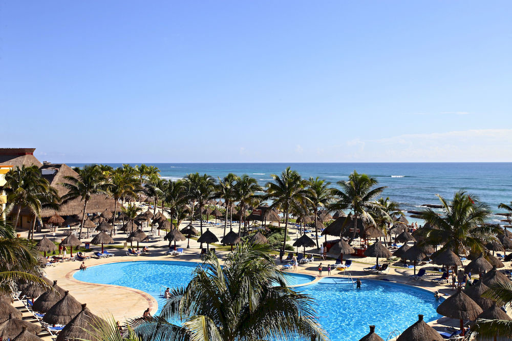 All-inclusive Beach Budget Family Pool Resort Tropical Waterfront water sky umbrella property leisure Sea swimming pool caribbean Ocean Nature Lagoon Coast shore overlooking lined swimming