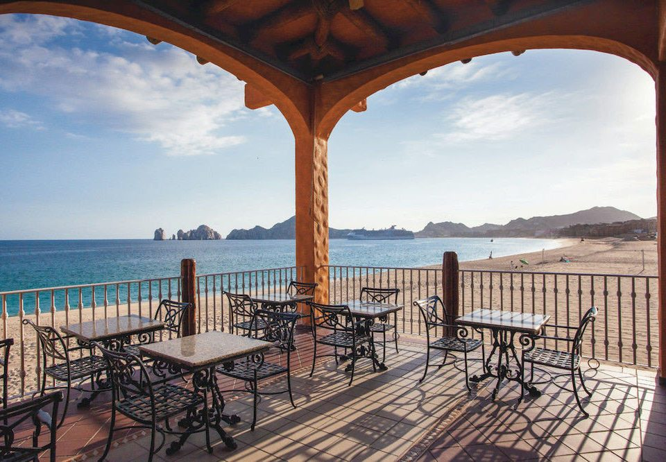 All-inclusive Beach Budget Dining Eat Family Resort Tropical sky water chair property Villa hacienda overlooking arch