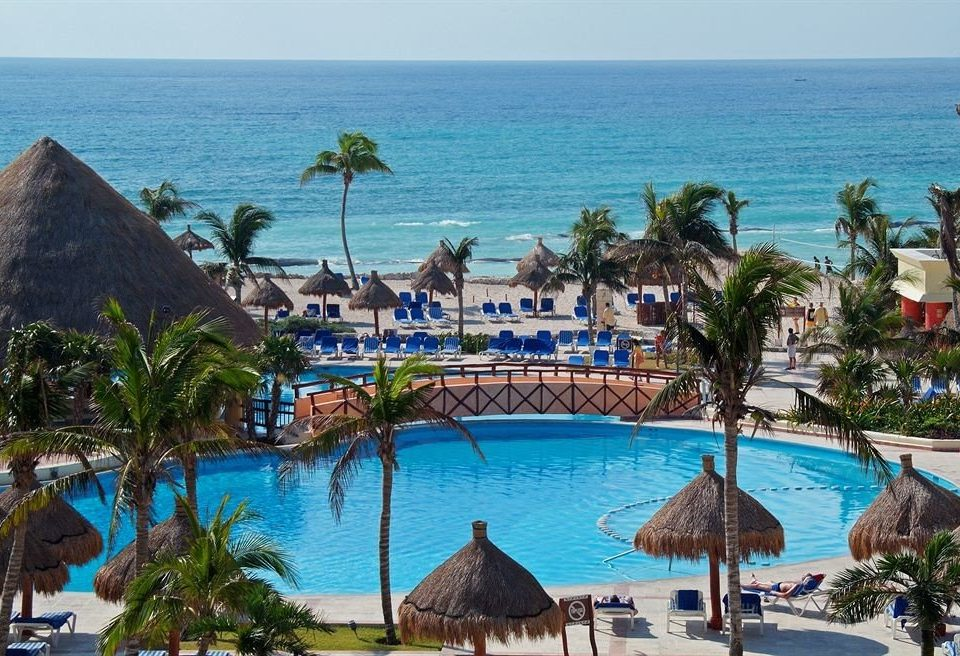 All-inclusive Beach Budget Family Pool Resort Tropical Waterfront water sky umbrella Ocean leisure caribbean swimming pool Nature Sea palm Water park shore amusement park Lagoon overlooking lined shade sandy Island day