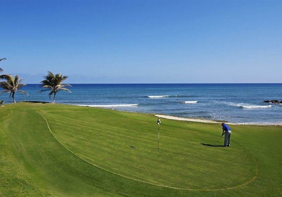 All-inclusive Beach Golf Sea sky water grass structure shore horizon Ocean Nature sport venue sports Coast golf course outdoor recreation golf club cape terrain