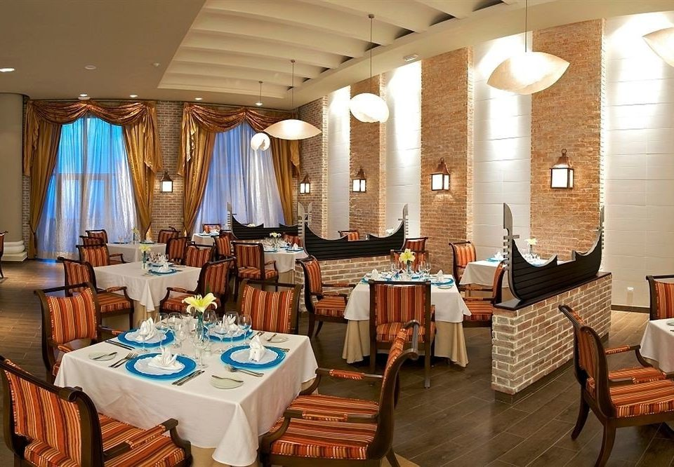 All-inclusive Beach Dining Eat Sea chair property restaurant Resort function hall Suite