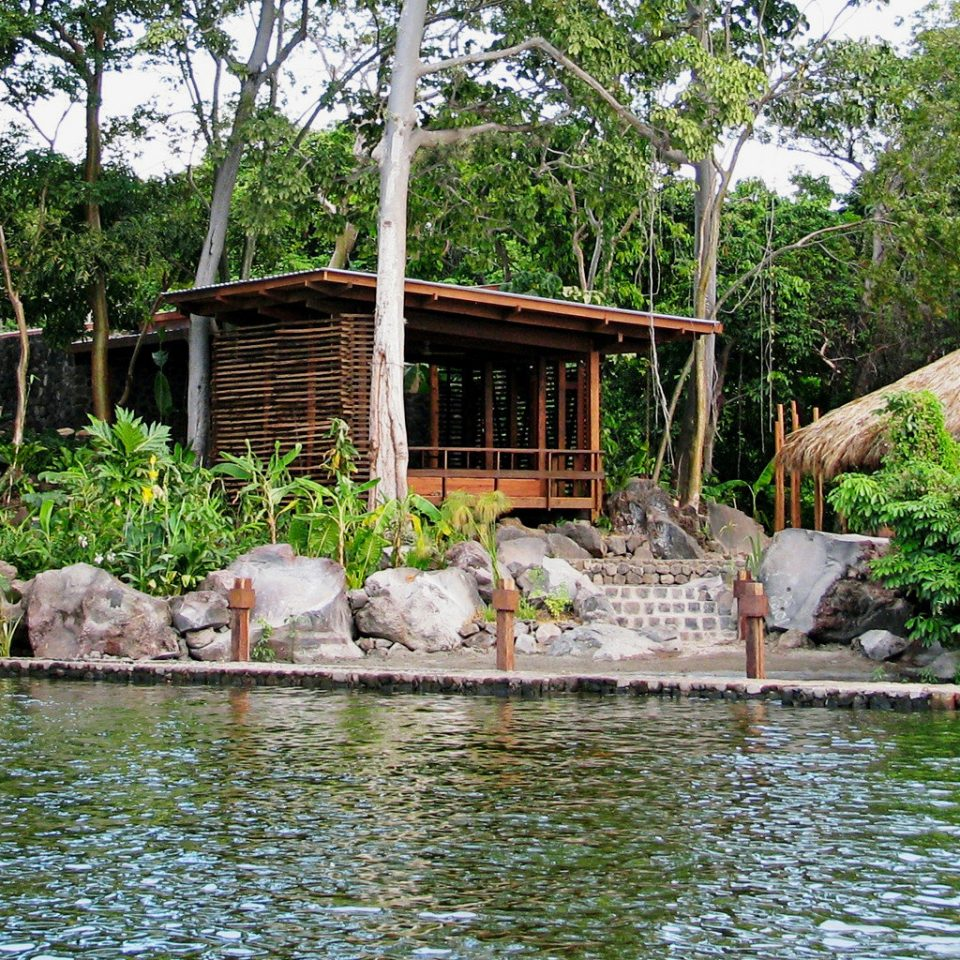 All-inclusive Beach Eco Resort Romantic Secret Getaways Trip Ideas Wellness tree Nature pond Jungle zoo Garden backyard swimming pool Village stone