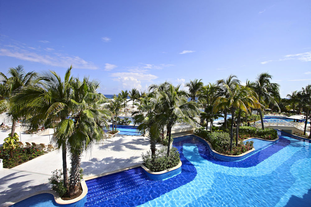 All-inclusive Family Honeymoon Pool Resort Tropical Waterfront tree sky swimming pool property leisure plant caribbean arecales resort town Villa Beach