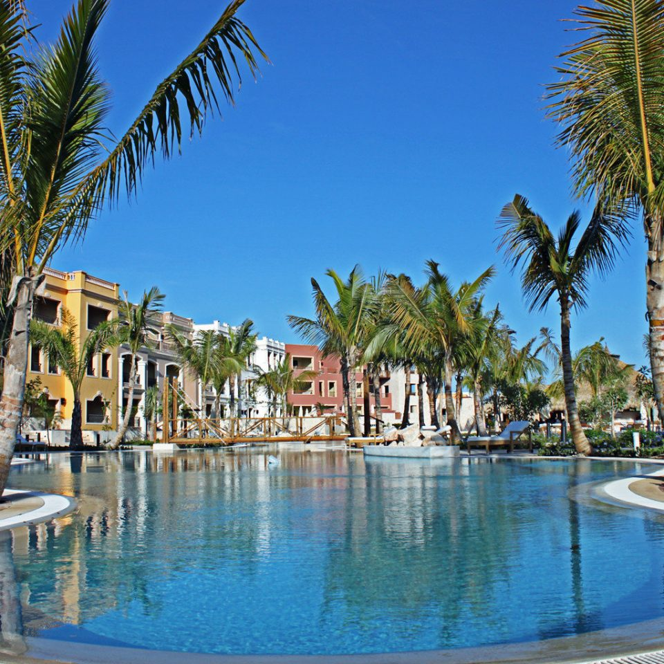 All-inclusive Family Pool Resort Romance Romantic Waterfront tree palm sky water Beach swimming pool property leisure arecales lined resort town caribbean Sea Lagoon Villa condominium marina swimming plant