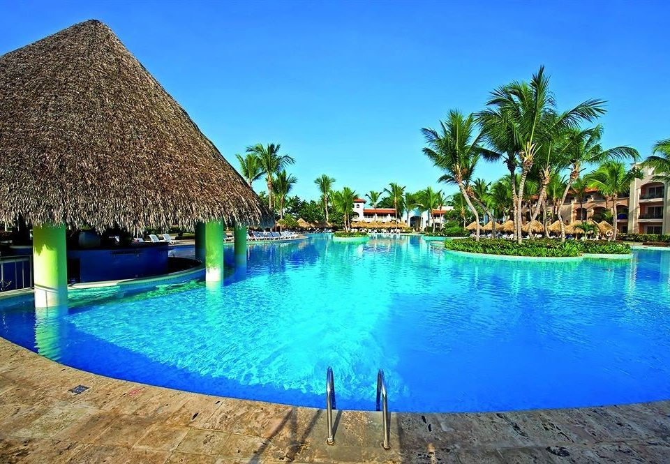All-inclusive Lounge Luxury Pool Resort water umbrella swimming pool property leisure Beach swimming blue resort town Lagoon Villa empty palm lined colored