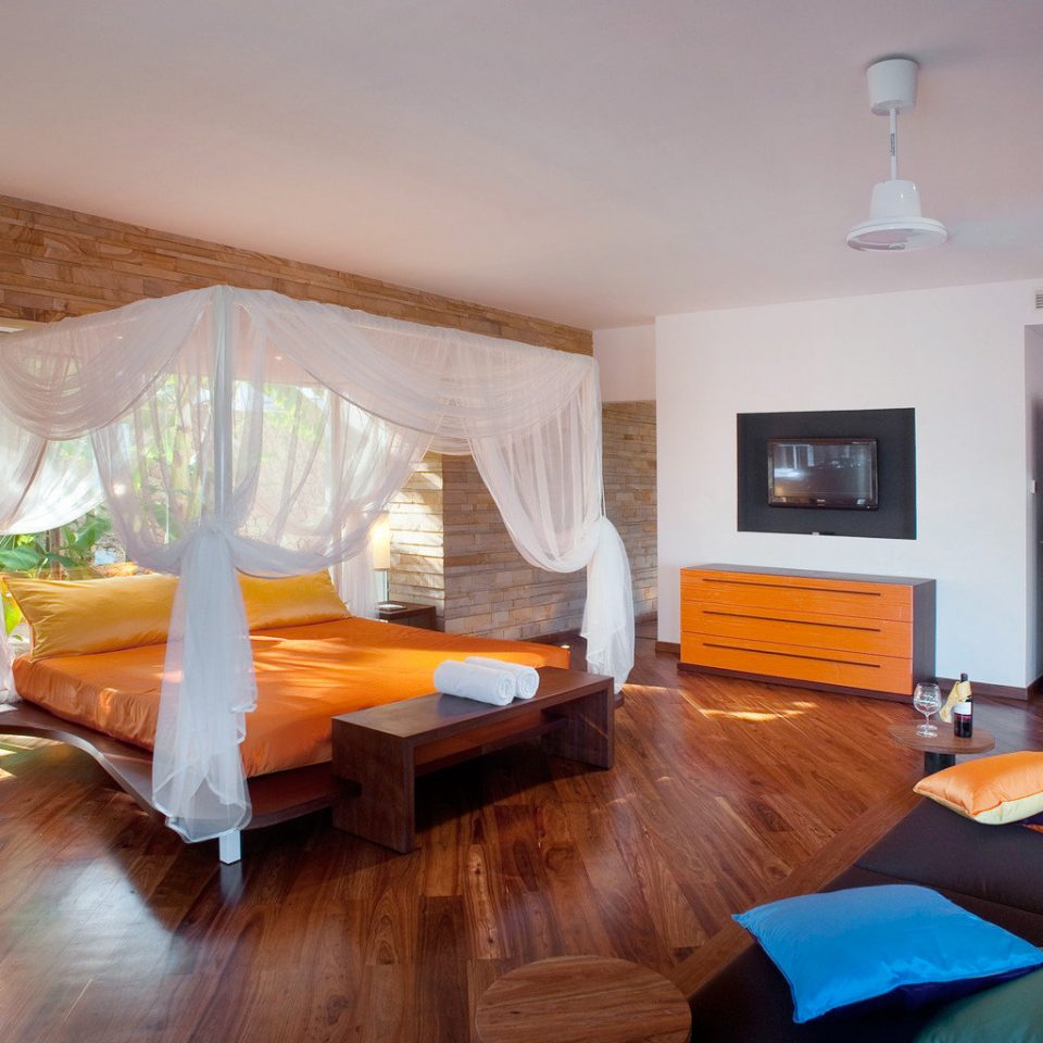 All-inclusive Beachfront Bedroom Luxury Resort property living room cottage hardwood home Villa Suite
