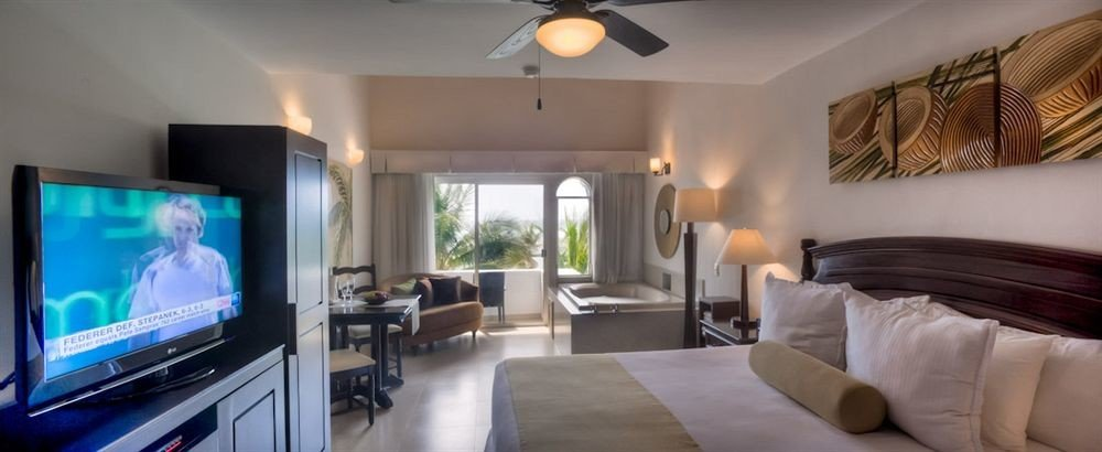 All-inclusive Beachfront Bedroom Modern Resort Waterfront property Suite living room condominium home flat