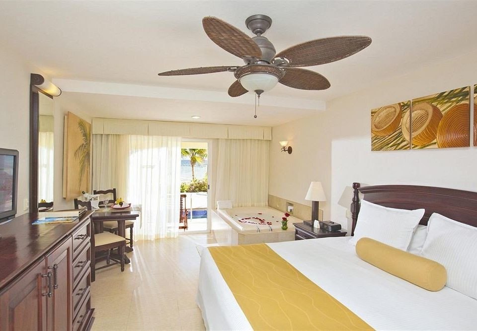 All-inclusive Beachfront Modern Resort Waterfront property home hardwood cottage living room Bedroom