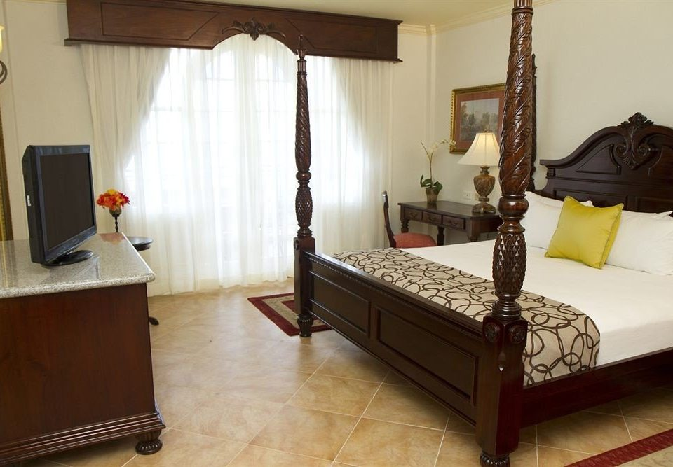 All-inclusive Beachfront Bedroom Tropical property hardwood home cottage Suite living room bed frame