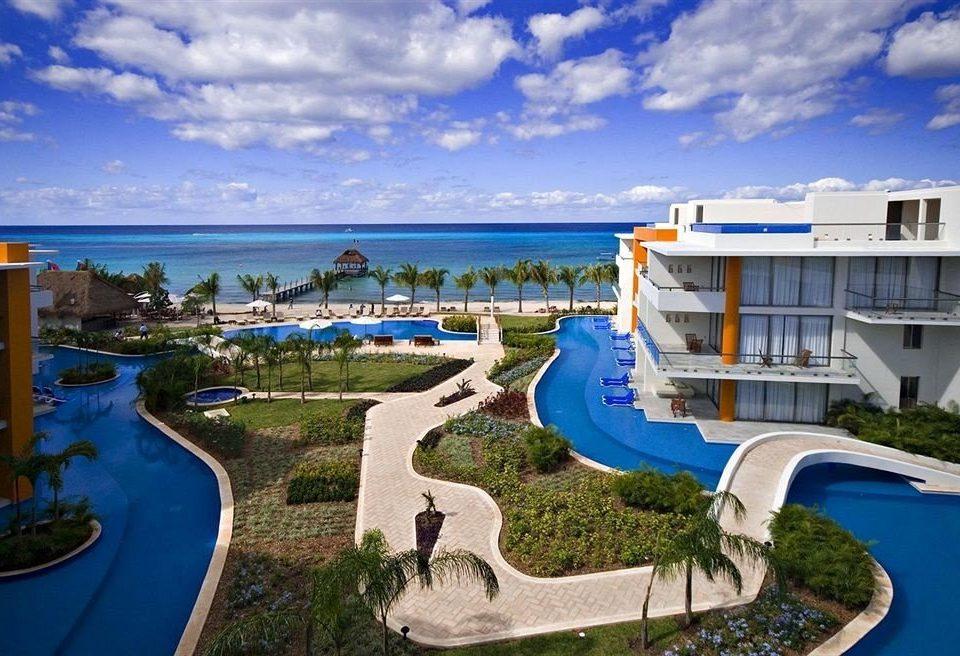 All-inclusive Beachfront Exterior Lounge Modern Pool Waterfront sky grass leisure marina Resort dock Sea Coast blue caribbean swimming pool