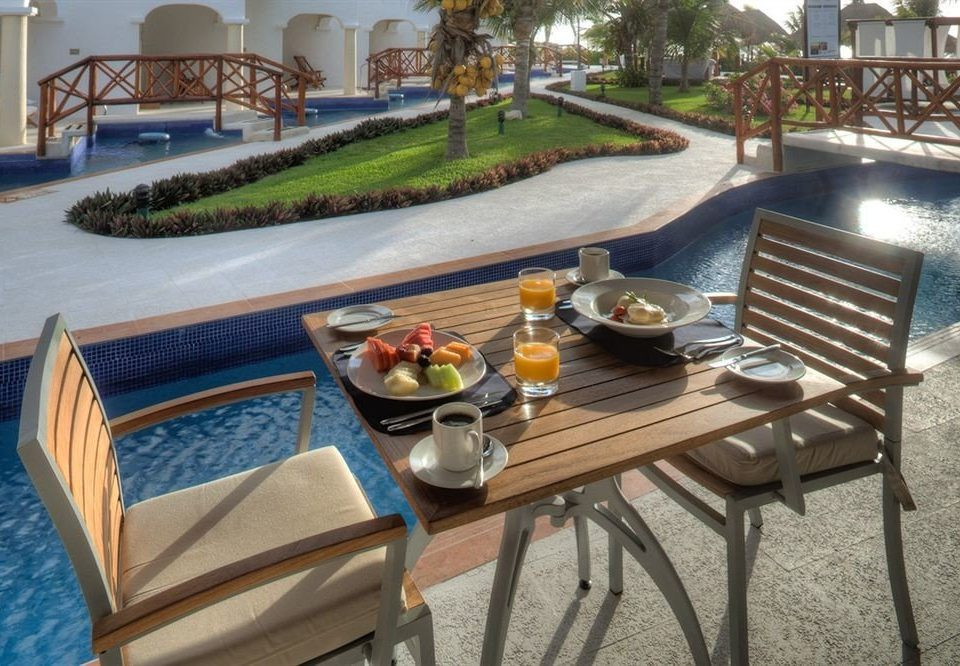 All-inclusive Beachfront Deck Dining Drink Eat Modern Resort Waterfront property chair vehicle Villa restaurant swimming pool dining table