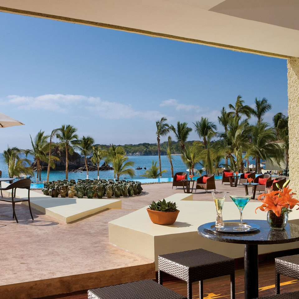 All-inclusive Beachfront Deck Drink Eat Modern Ocean Waterfront sky chair leisure property Resort Villa restaurant hacienda condominium swimming pool set Island