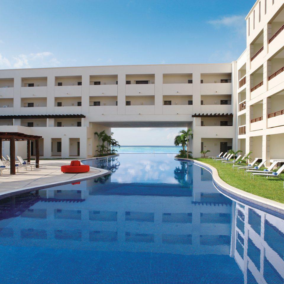 All-inclusive Beachfront Exterior Lounge Luxury Modern Pool building sky condominium swimming pool property leisure Resort plaza leisure centre reflecting pool Villa Deck colonnade