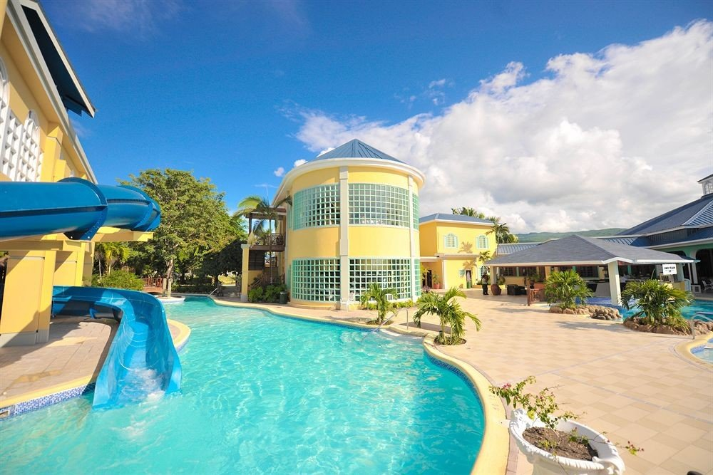 All-inclusive Beachfront Grounds Pool Resort Tropical sky swimming pool property leisure building Water park condominium caribbean Villa resort town amusement park Deck swimming