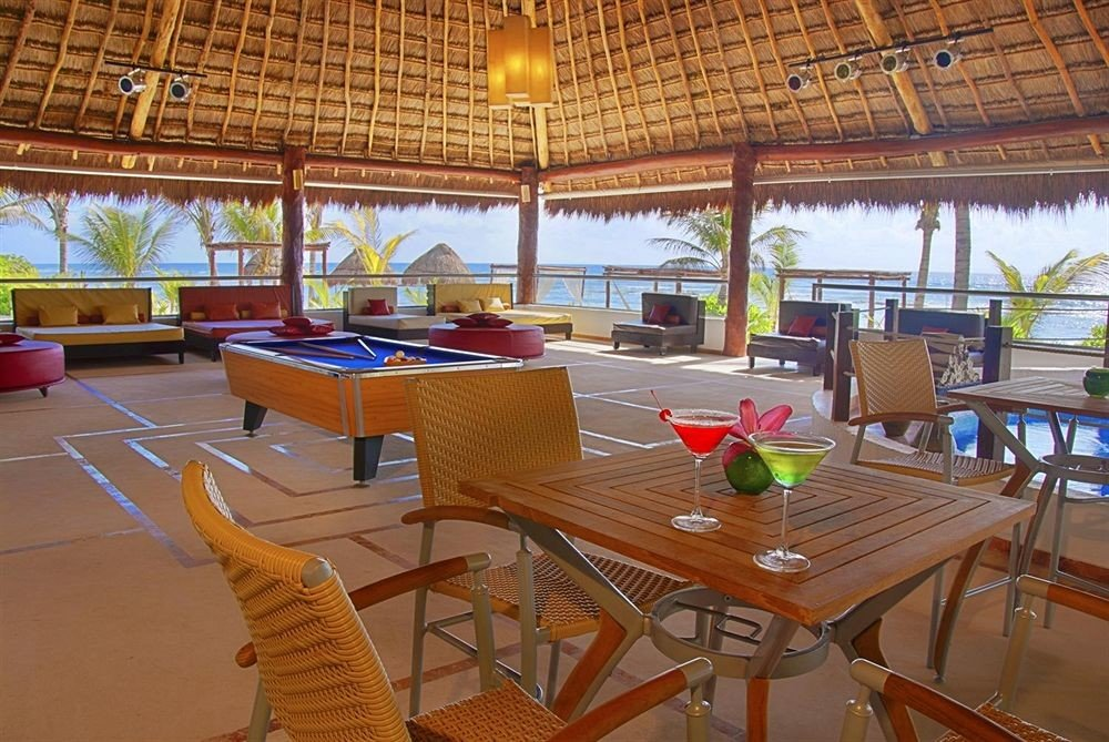 All-inclusive Beachfront Dining Drink Eat Modern Resort Waterfront vehicle restaurant recreation room