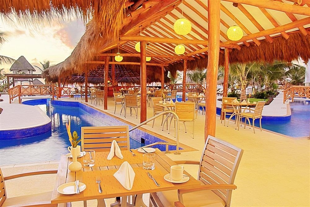 All-inclusive Beachfront Dining Drink Eat Modern Resort Waterfront chair leisure amusement park swimming pool Water park restaurant set