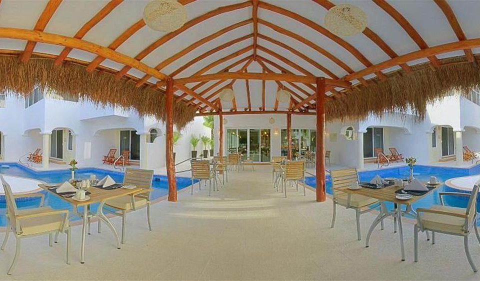 All-inclusive Beachfront Dining Drink Eat Modern Resort Waterfront chair umbrella leisure property hacienda Villa tent palace restaurant function hall blue