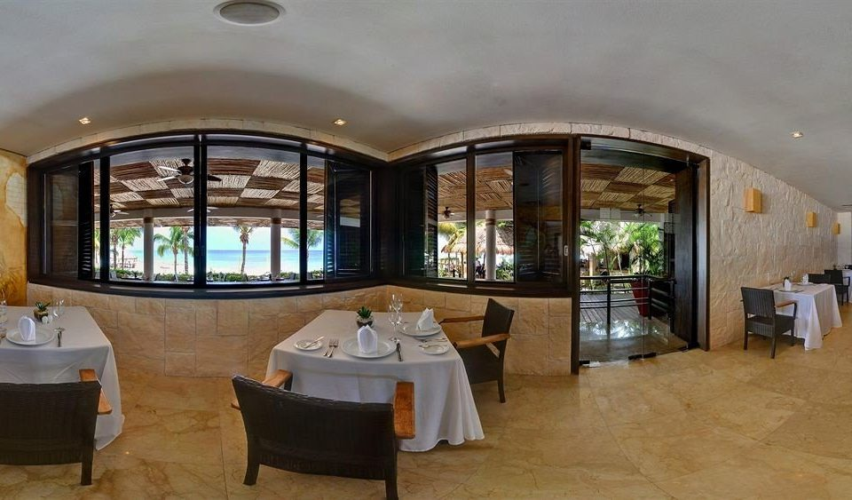 All-inclusive Beachfront Dining Drink Eat Modern Waterfront property home Resort restaurant Villa hacienda mansion Lobby living room cottage