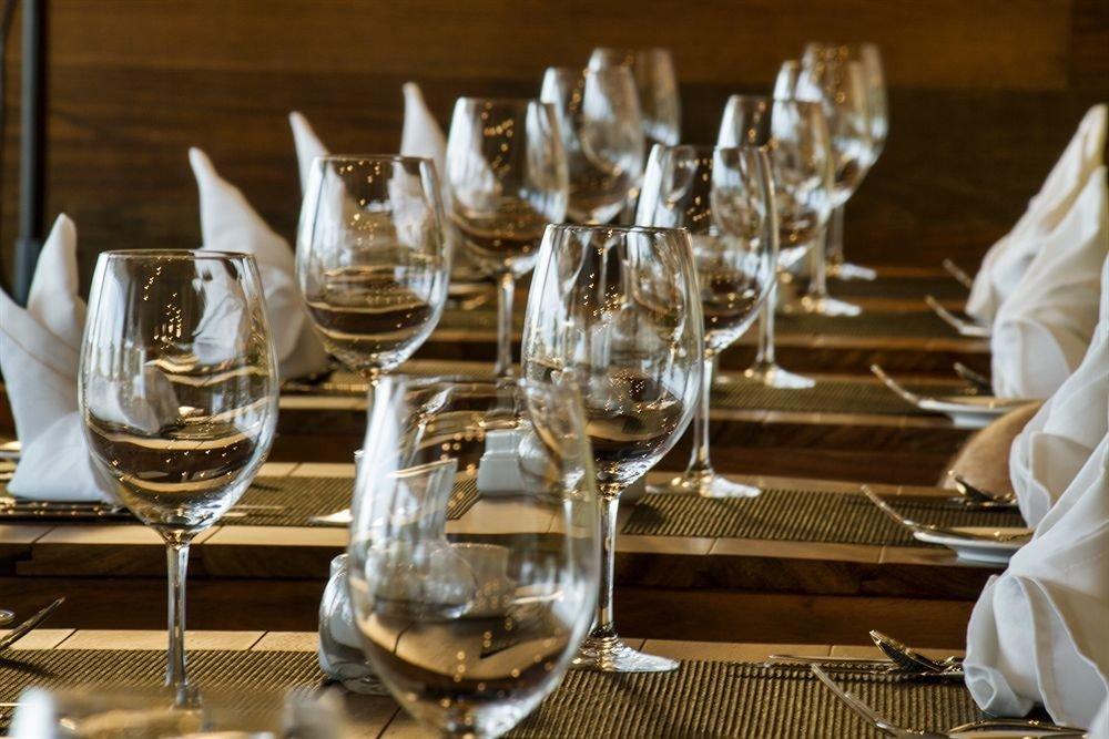 All-inclusive Beachfront Dining Drink Eat Modern Waterfront wine glasses restaurant dinner banquet ceremony rehearsal dinner wedding centrepiece function hall empty brunch wine glass glass