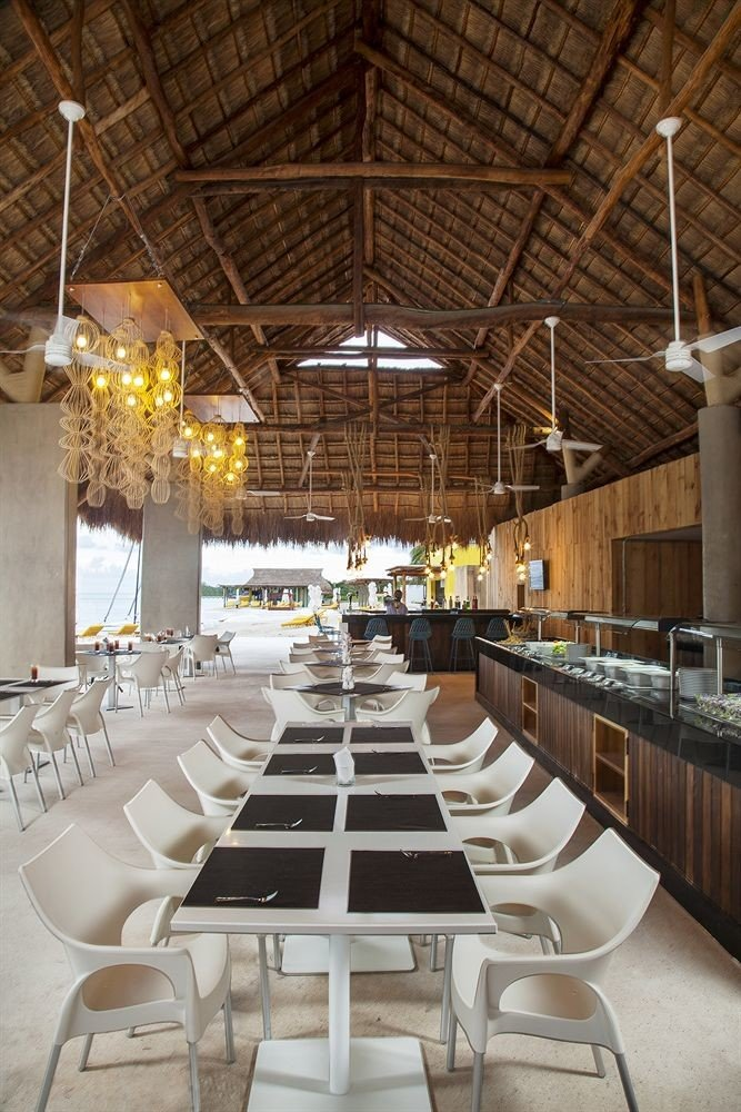 All-inclusive Beachfront Dining Drink Eat Modern Waterfront chair man made object aisle function hall restaurant