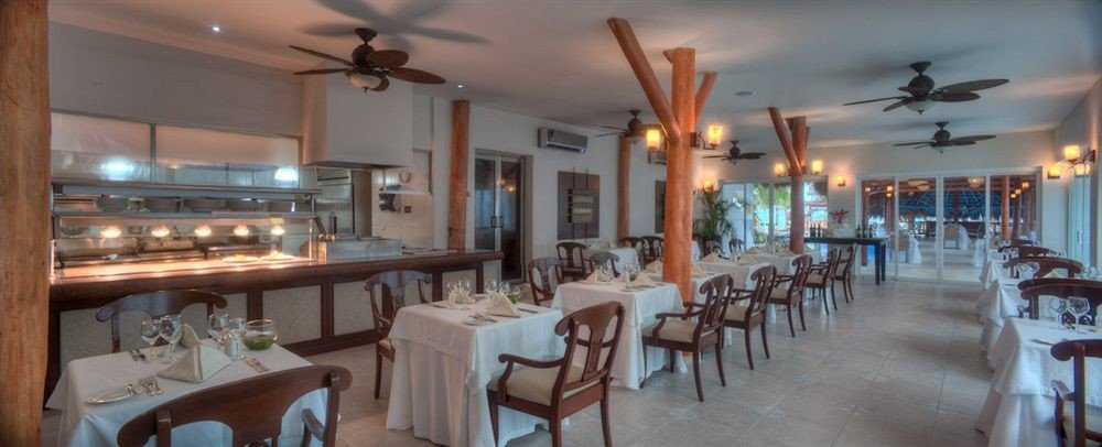 All-inclusive Beachfront Dining Drink Eat Modern Resort Waterfront chair property restaurant function hall palace Island