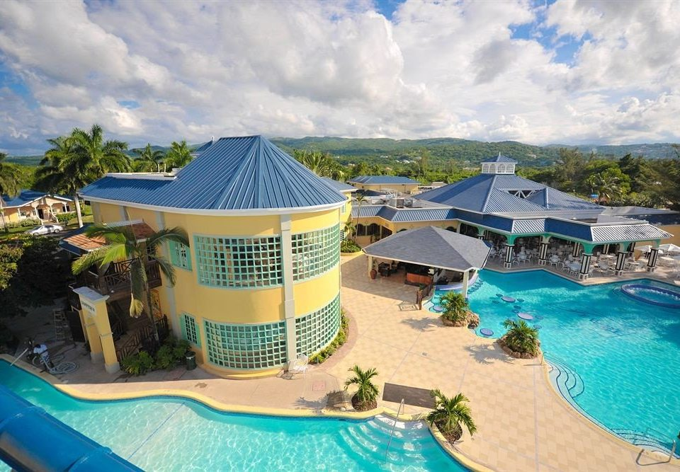 All-inclusive Beachfront Exterior Grounds Pool Resort Tropical swimming pool leisure property caribbean Water park resort town amusement park Sea
