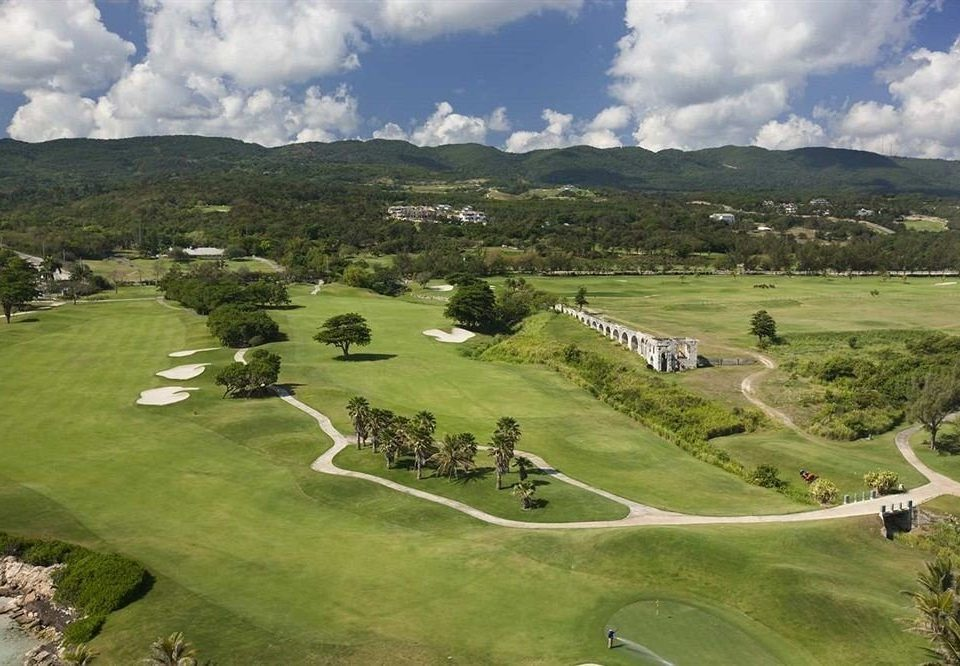 All-inclusive Beachfront Golf Tropical grass sky highland mountain structure Nature aerial photography grassland field hill sport venue grassy plain golf course mountain range golf club bird's eye view rural area sports plateau landscape meadow valley alps lush hillside